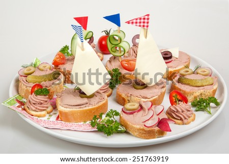 party platter with sandwiches with pate and vegetables - stock photo