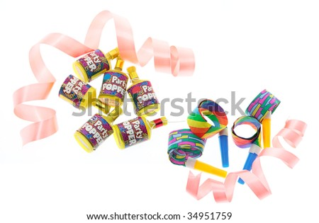 Party Poppers and Blowers on White Background - stock photo