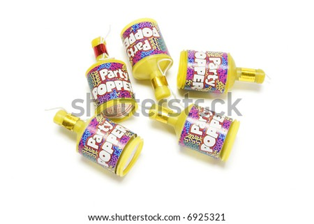 Party poppers on white background - stock photo