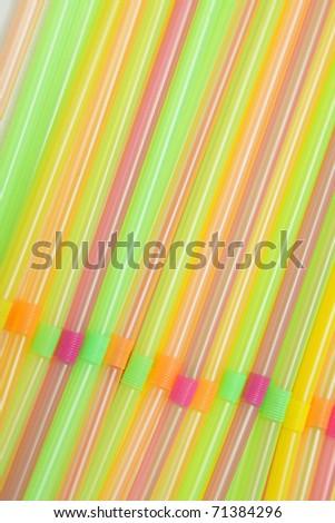 Party straws of various colors, closeup photo - stock photo