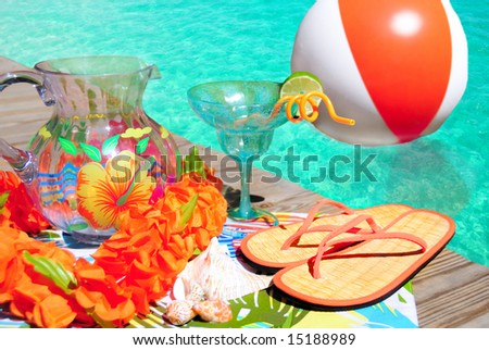 Party supplies on deck next to pretty pool - stock photo