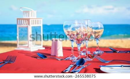 Party table on caribbean beach - stock photo