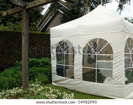 party tent in garden - stock photo