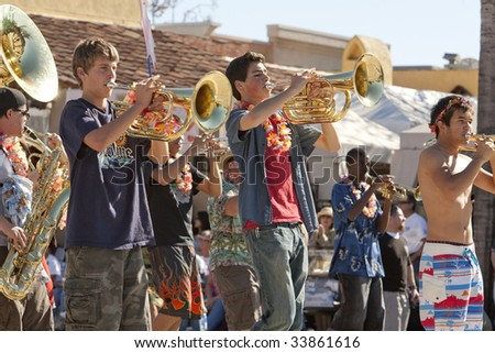 PASADENA, CA - JANUARY 18:  A Pasadena high-school band marches at the Doo Dah Parade on January 18th in Pasadena, CA.  The Doo Dah Parade is a parody of Pasadena's more famous Rose Parade. - stock photo