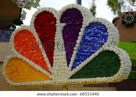 PASADENA, CA - JANUARY 1 2011: NBC logo made with flower petals on Rose Parade Float of Burbank city at the 122nd Tournament of Roses Parade on January 1 2011 in Pasadena California - stock photo