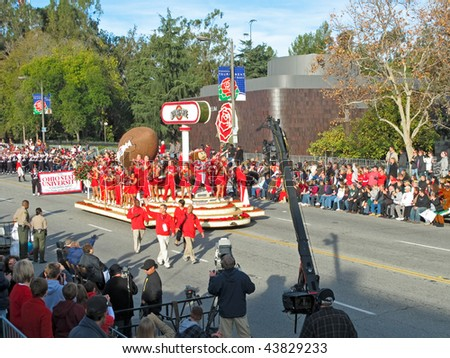 PASADENA, CA - JANUARY 1: Ohio State University's Marching Band proudly perform along with The OSU float in the 121st Tournament of Roses Parade January 1, 2010 in Pasadena, California. - stock photo