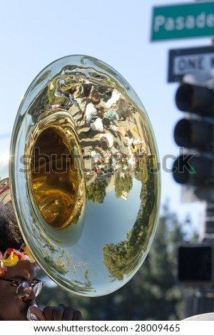 PASADENA, CA - JANUARY 18 : Reflection of  Pasadena high-school band marches at the Doo Dah Parade on January 18, 2009 in Pasadena. The parade is a parody of Pasadena's more famous Rose Parade. - stock photo