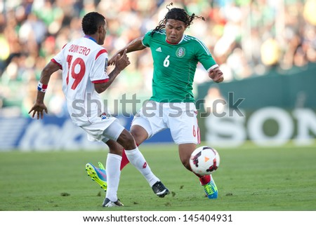 PASADENA, CA - JULY 7: Carlos Pena #6 of Mexico and Alberto Quintero #19 of Panama during the 2013 CONCACAF Gold Cup game between Mexico and Panama on July 7, 2013 at the Rose Bowl in Pasadena, Ca. - stock photo