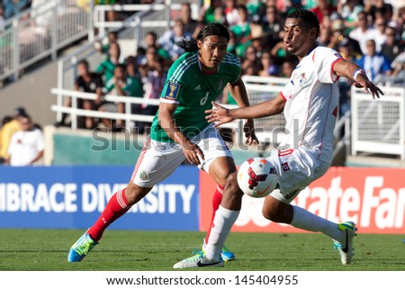 PASADENA, CA - JULY 7: Carlos Pena #6 of Mexico and Anibal Godoy #20 of Panama during the 2013 CONCACAF Gold Cup game between Mexico and Panama on July 7, 2013 at the Rose Bowl in Pasadena, Ca. - stock photo