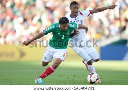 PASADENA, CA - JULY 7: Carlos Pena #6 of Mexico and Gabriel Torres #9 of Panama during the 2013 CONCACAF Gold Cup game between Mexico and Panama on July 7, 2013 at the Rose Bowl in Pasadena, Ca. - stock photo