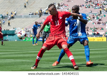 PASADENA, CA - JULY 7: Jean Sylvain Babin #22 of Martinique & Marcus Haber #11 of Canada during the 2013 CONCACAF Gold Cup game between Canada & Martinique on July 7, 2013 at the Rose Bowl. - stock photo