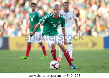 PASADENA, CA - JULY 7: Jorge Enriquez #14 of Mexico during the 2013 CONCACAF Gold Cup game between Mexico and Panama on July 7, 2013 at the Rose Bowl in Pasadena, Ca. - stock photo