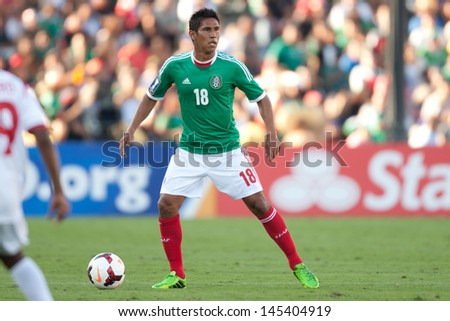 PASADENA, CA - JULY 7: Juan Carlos Valenzuela #18 of Mexico during the 2013 CONCACAF Gold Cup game between Mexico and Panama on July 7, 2013 at the Rose Bowl in Pasadena, Ca. - stock photo