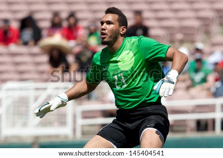 PASADENA, CA - JULY 7: Kevin Olimpa #23 of Martinique during the 2013 CONCACAF Gold Cup game between Canada and Martinique on July 7, 2013 at the Rose Bowl in Pasadena, Ca. - stock photo