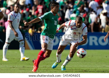 PASADENA, CA - JULY 7: Marco Fabian #10 of Mexico and Gabriel Gomez #6 of Panama during the 2013 CONCACAF Gold Cup game between Mexico and Panama on July 7, 2013 at the Rose Bowl in Pasadena, Ca. - stock photo