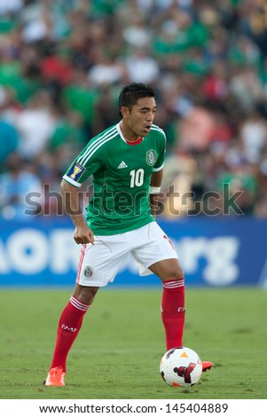 PASADENA, CA - JULY 7: Marco Fabian #10 of Mexico during the 2013 CONCACAF Gold Cup game between Mexico and Panama on July 7, 2013 at the Rose Bowl in Pasadena, Ca. - stock photo