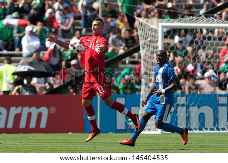 PASADENA, CA - JULY 7: Marcus Haber #11 of Canada in action during the 2013 CONCACAF Gold Cup game between Canada and Martinique on July 7, 2013 at the Rose Bowl in Pasadena, Ca. - stock photo