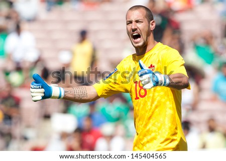 PASADENA, CA - JULY 7: Milan Borjan #18 of Canada during the 2013 CONCACAF Gold Cup game between Canada and Martinique on July 7, 2013 at the Rose Bowl in Pasadena, Ca. - stock photo