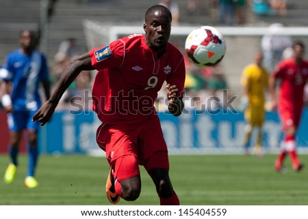 PASADENA, CA - JULY 7: Tosaint Ricketts #9 of Canada chases down the ball during the 2013 CONCACAF Gold Cup game between Canada and Martinique on July 7, 2013 at the Rose Bowl in Pasadena, Ca. - stock photo
