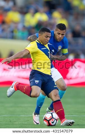 PASADENA, CA - JUNE 4: Dani Alves (R) & Jefferson Montero during the COPA America game between Brazil & Ecuador on June 4th 2016 at the Rose Bowl in Pasadena, Ca. - stock photo