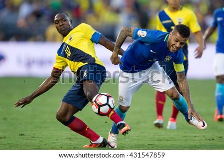 PASADENA, CA - JUNE 4: Walter Ayovi (L) & Dani Alves during the COPA America game between Brazil & Ecuador on June 4th 2016 at the Rose Bowl in Pasadena, Ca. - stock photo