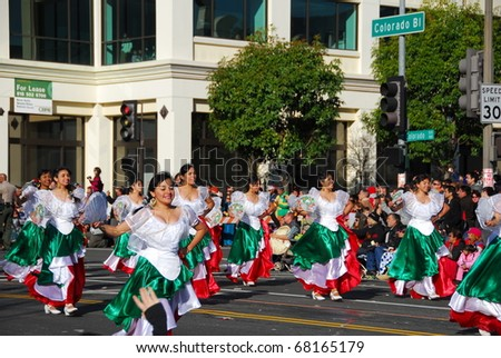 PASADENA, CA/USA - JANUARY 1: Banda Musical Delfines Xalapa Veracruz Mexico dance performance at the 122nd tournament of roses Rose Parade on January 1 2011 in Pasadena California - stock photo