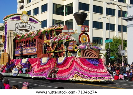 PASADENA, CA/USA - JANUARY 1: It's time to face alzheimer's float by pfizer and alzheimer foundation at tournament of roses Rose Parade on January 1, 2011 in Pasadena, California - stock photo