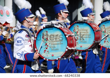 PASADENA, CA/USA - JANUARY 1: Londonderry high school marching lancer band and color guard New Hampshire performs at the 122nd tournament of roses Rose Parade on January 1 2011 in Pasadena California - stock photo