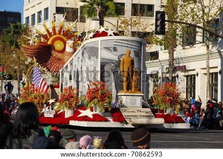 PASADENA, CA/USA - JANUARY 1: Ronald Reagan Presidential Foundation Ronald Reagan Inspired Freedom Changed The World float at the 122nd tournament of roses Jan 1, 2011 Rose Parade in Pasadena California - stock photo