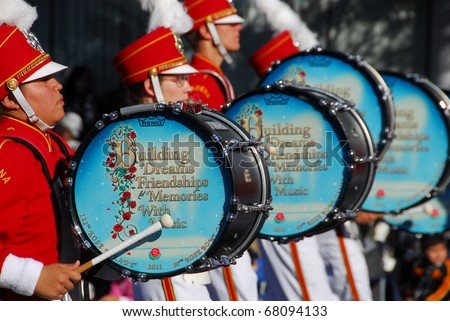 PASADENA, CA/USA - JANUARY 1: The  delfines marching band drummer beating drums at tournament of roses Rose Parade on January 1, 2011 in Pasadena, California - stock photo