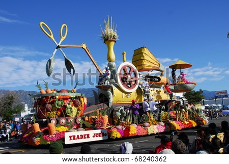 PASADENA, CA/USA - JANUARY 1: Trader Joe's Exploring Planet Dinner float at the 122nd tournament of roses Rose Parade on January 1 2011 in Pasadena California - stock photo
