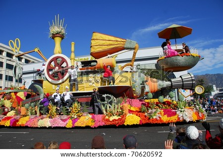 PASADENA, CA/USA - JANUARY 1: Trader Joe's Exploring Planet Dinner float at the 122nd tournament of roses Rose Parade on January 1, 2011 in Pasadena California - stock photo