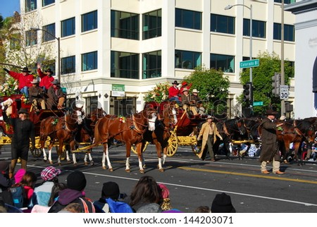 PASADENA, CA/USA - JANUARY 1: Wells Fargo Bank Horse Carriage float at the 122nd tournament of roses Rose Parade on January 1 2011 in Pasadena California - stock photo
