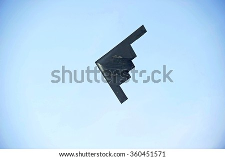 """PASADENA/CALIFORNIA - JANUARY 1, 2016: Northrup B-2 Spirit """"Stealth Bomber"""" performs a fly by before the start of the Rose Bowl game on New Years Day in Pasadena, California USA - stock photo"""