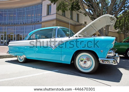 "PASADENA/CALIFORNIA - JUNE 19, 2016: A Classic 1955 Ford Fairlane ""Victoria"" parked along the road in Pasadena, California USA"