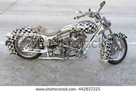 PASADENA, CALIFORNIA - JUNE 25, 2016: A custom built and custom painted motorcycle parked along Lake Street in Pasadena, California USA