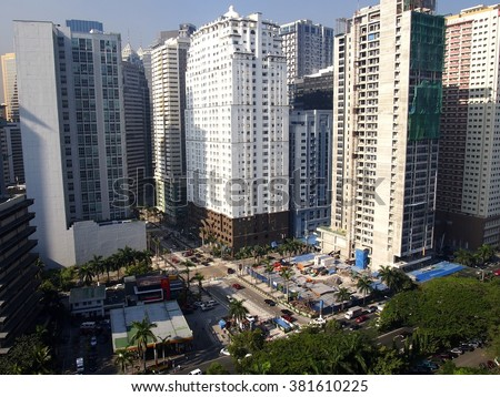 PASIG CITY, PHILIPPINES - JANUARY 14, 2016: Commercial and residential buildings in Ortigas Center in Pasig City, Philippines - stock photo