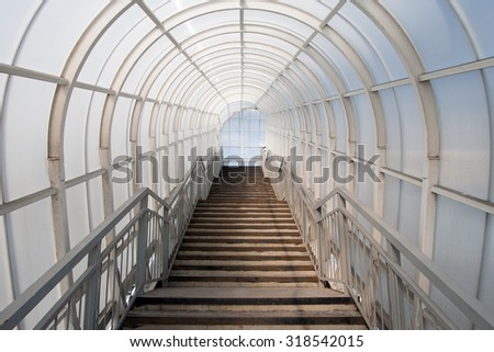Passage in glass corridor inside a modern building - stock photo