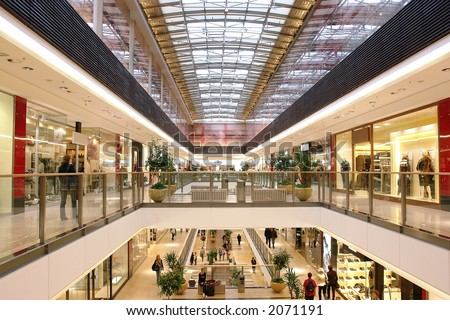 Passage in multilevel shopping mall - stock photo
