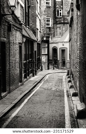 Passage in Whitechapel, the district where Jack the Ripper committed his crimes, London.  - stock photo