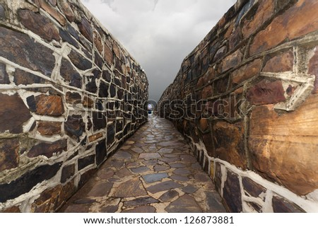 Passage through a hill, open tunnel. - stock photo