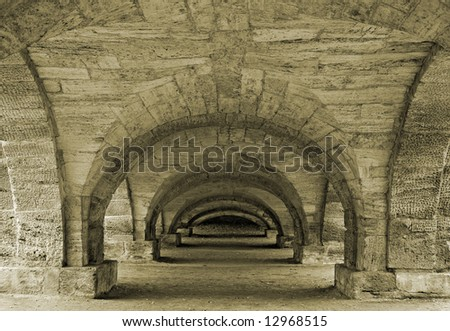 Passage under a decorative bridge in a town of Pushkin, near Saint-Petersburg - stock photo