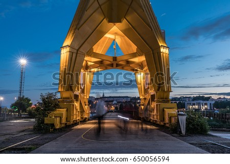 stock-photo-passage-under-the-yellow-cra
