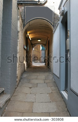 Passage way in Soho, London UK, with blank sign over archway - stock photo