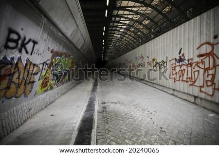 Passage with graffiti covered walls - stock photo