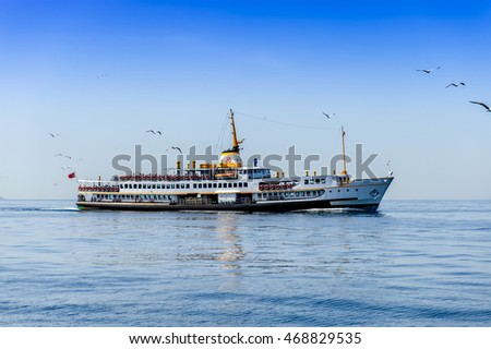 Passanger ship with seagulls above it in Black sea near Istanbul, Turkey.