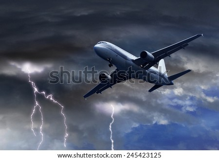 Passenger air plane approaching turbulent thunderstorm lightning - stock photo