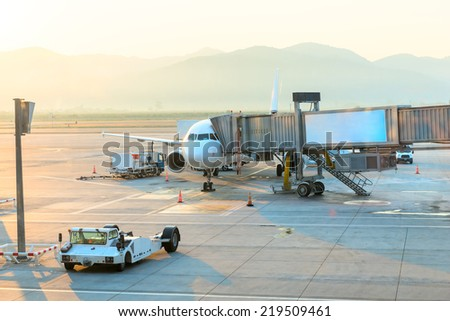 passenger aircraft at the airport with access to boarding - stock photo
