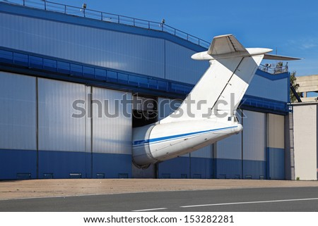 Passenger aircraft in the hangar for repairs and maintenance - stock photo