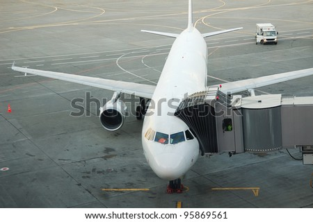 passenger aircraft is being boarded - stock photo